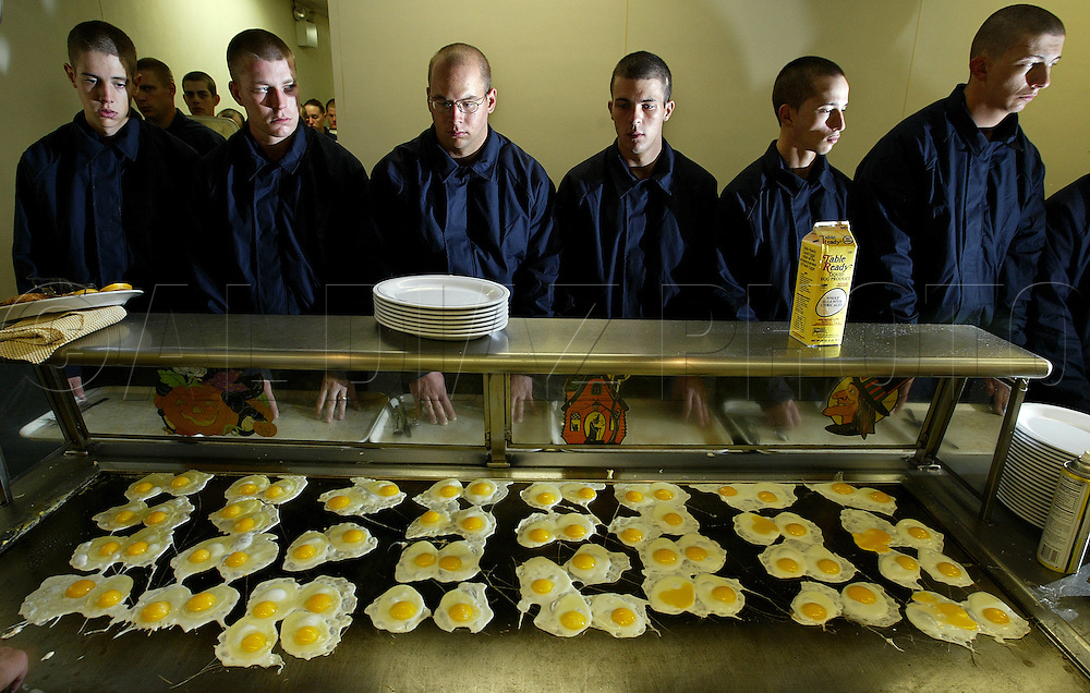 Cadets, Dustin Fisler, Joshua, D. Keane, Erick S. Carleton, Ryan Stephan Theilemann wait for breakfast at the base galley as they go through the rigors of Boot Camp at The United States Coast Guard Training Center in Cape May, NJ.