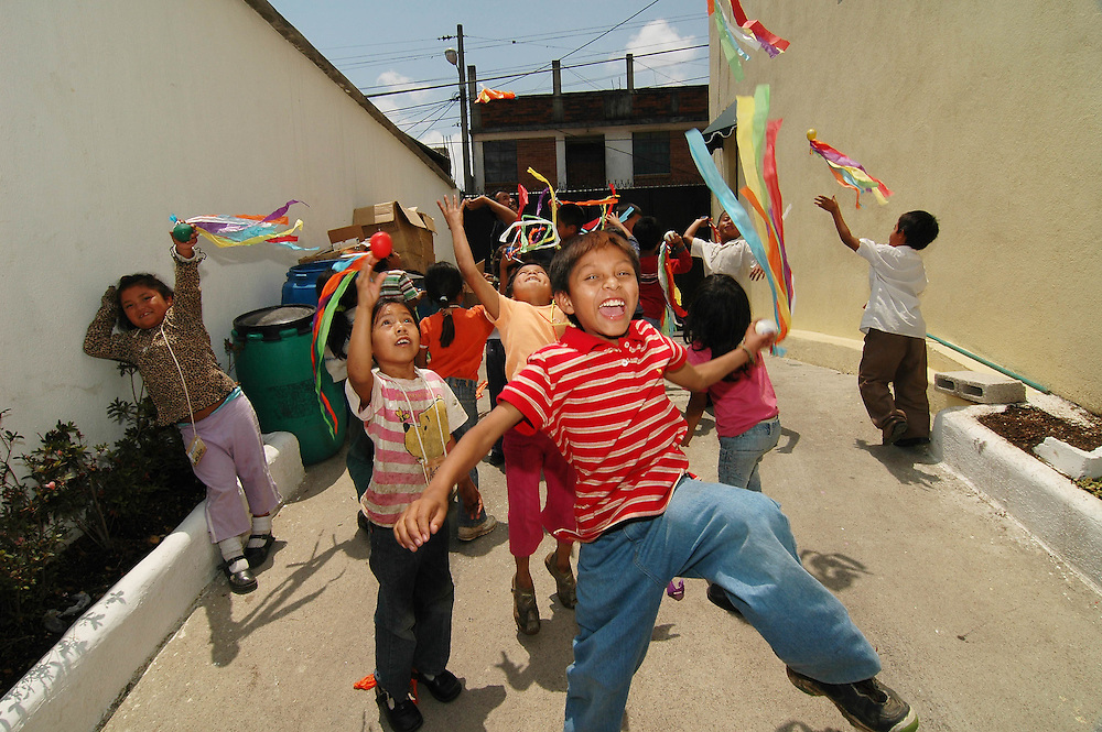 Students  play inside the Safe Passage Main School in Guatemala City.