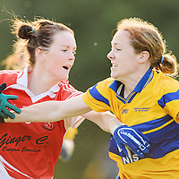 6 October 2012; Amanda Casey, Donaghmoyne, Co. Monaghan, in action against Sinead O'Keeffe, Banner, Co. Clare, during the Senior Championship Final. 2012 Tesco All-Ireland Ladies Football Club Sevens. Naomh Mearnóg GAA Club, Portmarnock, Co. Dublin. Picture credit: Paul Mohan / SPORTSFILE *** NO REPRODUCTION FEE ***