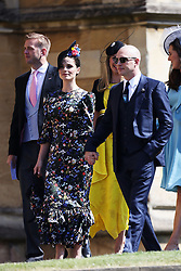Charlotte Riley and Tom Hardy arrive at St George's Chapel in Windsor Castle for the wedding of Prince Harry and Meghan Markle.