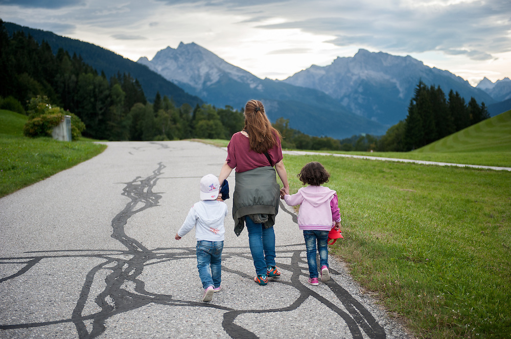 """Afternoon, Wednesday 16th of September 2015. Zinkenwirt Gmerk, Berchtesgaden, Bavaria. Aysha and her daughters are now in Germany. The landscape remind me of the movie """"The Sound of Music""""  They walked few meters to a bus station where they were planning to take the bus to the nearest train station and fro there to continue to Munich. Few minutes after this picture was taken a van of the Bavarian State Police came and pic them up. They were taken to a refugee first welcome centre where I would meet them few hours later. Then we took the train to Munich where the were taken to the refugee centre. I wouldn't meet them for 5 months."""