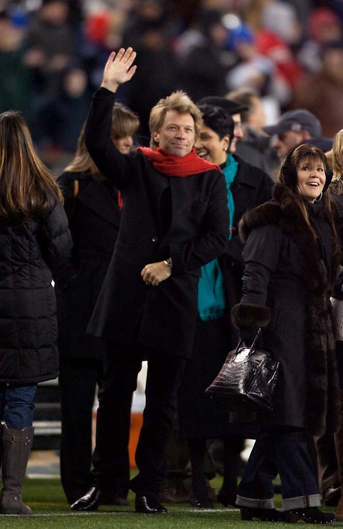 Foxborough, MA 01/14/2012.Musician John Bon Jovi waves from the sideline of Saturday's AFC Divisional game between the New England Patriots and the Denver Broncos..Wicked Local Photo by Alex Jones