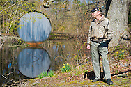 April 21, 2013 - Roslyn Harbor, New York, U.S. - At Celebrate Earth Day at Nassau County Museum of Art, science educators took visitors to explore organisms in the Museum's ponds. Wood Duck, by sculpture Allen Bertoldi, is the large round painted steel sculpture, 15 x 15 x1 foot, in the pond behind the museum mansion.