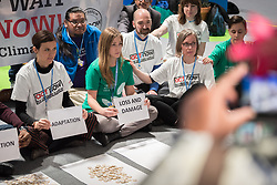 "11 December 2019, Madrid, Spain: ACT Alliance, Lutheran World Federation and World Council of Churches participants at COP25 illustrate the lack of balance in finance of the global climate response, where most ofthe finance is put into mitigation, some into adaptation, but very little into loss and damage, even though 'that's where the people are'. 'What do we want? Climate justice. When do we want it? Now!"" they chanted, as Erika Rodning from the Evangelical Lutheran Church in Canada held a sign reading 'Loss and Damage' in front of a table empty of finance."