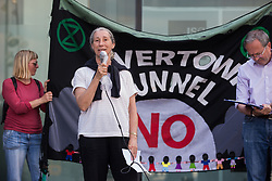 London, UK. 5th June, 2021. A speaker from Fossil Free Newham addresses environmental activists and local residents protesting against the construction of the Silvertown Tunnel. Campaigners opposed to the controversial new £2bn road link across the River Thames from the Tidal Basin Roundabout in Silvertown to Greenwich Peninsula argue that it is incompatible with the UK's climate change commitments because it will attract more traffic and so also increased congestion and air pollution to the most polluted borough of London.