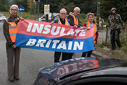 Climate activists from Insulate Britain block a slip road from the M25, causing a long tailback on the motorway, as part of a new campaign intended to push the UK government to make significant legislative change to start lowering emissions on 13th September 2021 in Godstone, United Kingdom. The activists, who wrote to Prime Minister Boris Johnson on 13th August, are demanding that the government immediately promises both to fully fund and ensure the insulation of all social housing in Britain by 2025 and to produce within four months a legally binding national plan to fully fund and ensure the full low-energy and low-carbon whole-house retrofit, with no externalised costs, of all homes in Britain by 2030 as part of a just transition to full decarbonisation of all parts of society and the economy.