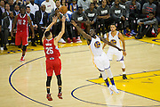 Golden State Warriors forward Draymond Green (23) attempts to block a jump shot by Los Angeles Clippers guard Austin Rivers (25) during a NBA preseason game at Oracle Arena in Oakland, Calif., on October 4, 2016. (Stan Olszewski/Special to S.F. Examiner)