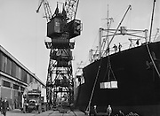Crates being loaded onto ships at King George V docks, Peek Frean biscuit company, England UK, c. 1932