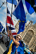 Anti Brexit protesters outside Parliament, Westminster, London as Members of Parliament debate the European Union withdrawal bill, June 20th 2018. A protester waving a Union Jack and European flags.