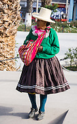 Woman with red bag in Yungay, in the Andes Mountains, Ancash Region, Peru, South America