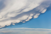 """Detail of lumpy mammatus (""""mammary"""") clouds on the underside of a storm cloud in Never Summer Wilderness, Colorado."""