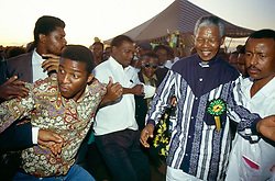NELSON ROLIHLAHLA MANDELA (July 18, 1918 - December 5, 2013), 95, world renown civil rights activist and world leader. Mandela emerged from prison to become the first black President of South Africa in 1994. As a symbol of peacemaking, he won the 1993 Nobel Peace Prize. Joined his countries anti-apartheid movement in his 20s and then the ANC (African National Congress) in 1942. For next 20 years, he directed a campaign of peaceful, non-violent defiance against the South African government and its racist policies and for his efforts was incarcerated for 27 years. Remained strong and faithful to his cause, thru out his life, of a world of peace. Transforming the world, to make it a better place. PICTURED: 1994 - Northern Cape, South Africa - NELSON MANDELA at a rally.  (Credit Image: © Greg Marinovich/ZUMA Wire/ZUMAPRESS.com)