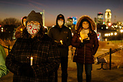 21 DECEMBER 2020 - DES MOINES, IOWA: People with electric candles at a memorial vigil for the homeless people who have died in Iowa in 2020. Downtown Des Moines is in the background. More than 100 people gathered on the steps of the State Capitol in Des Moines to honor the homeless who died in Iowa in 2020. The ceremony is held every year on December 21, the longest night of the year. Twenty-five homeless people have died in Iowa so far in 2020.     PHOTO BY JACK KURTZ