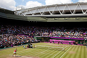 Crowds watch in Centre Court as the Tennis events at the London 2012 Olympics take place at Wimbledon. Serena Williams versus Maria Sharapova in the women's gold medal match.