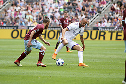 April 29, 2018 - Commerce City, Colorado - Orlando City SC forward Justin Meram (9) battles with Colorado Rapids midfielder Enzo Martínez (90) in the first half of action in the MLS soccer game between Orlando City SC and the Colorado Rapids at Dick's Sporting Goods Park in Commerce City, Colorado (Credit Image: © Carl Auer via ZUMA Wire)