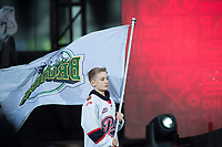 REGINA, SK - MAY 17: Will Mitchell holds a Humboldt Broncos flag in the wind during the opening ceremonies at Mosaic Stadium on May 17, 2018 in Regina, Canada. (Photo by Marissa Baecker/Shoot the Breeze)