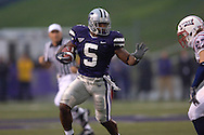 Kansas State running back Thomas Clayton (5) rushes upfield against Florida Atlantic's Kris Bartels (R) in the first half at Bill Snyder Family Stadium in Manhattan, Kansas, September 9, 2006.  The Wildcats beat the Owls 45-0.