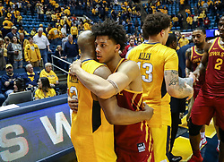 Feb 24, 2018; Morgantown, WV, USA; West Virginia Mountaineers guard Jevon Carter (2) and Iowa State Cyclones guard Lindell Wigginton (5) talk after the game at WVU Coliseum. Mandatory Credit: Ben Queen-USA TODAY Sports