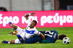 Dimitris Kourbelis of Greece vs Benjamin Verbic of Slovenia during football match between National teams of Greece and Slovenia in Final tournament of Group Stage of UEFA Nations League 2020, on November 18, 2020 in Georgios Kamaras Stadium, Athens, Greece. Photo by MATTHAIOS YORGOS / INTIME SPORTS / SPORTIDA