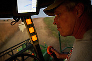 Here, Loftin is seen lining up the combine for a new row of soybeans to harvest. Since the advent of GPS technologies, much of the work of precise zig-zag maneuvering is now left to computers..