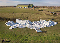 FILE IMAGE © Licensed to London News Pictures. 13/01/2019. Bedford, UK. In this file image from 19/11/2017 the deflated remains of the Airlander 10 airship are seen in a field near Cardington air sheds. The world's longest aircraft collapsed to the ground after breaking free from it's mooring. It has been announced that it will be permanently grounded as developers design and build a replacement. Photo credit: Peter Macdiarmid/LNP