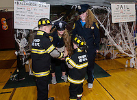 Gilford Police Cassidy Bartlett and Julia Harris and Gilford Fire Cameron and Jacoby Drouin were keeping the peace during the Halloween Party Friday evening at Gilford Middle School.  (Karen Bobotas/for the Laconia Daily Sun)