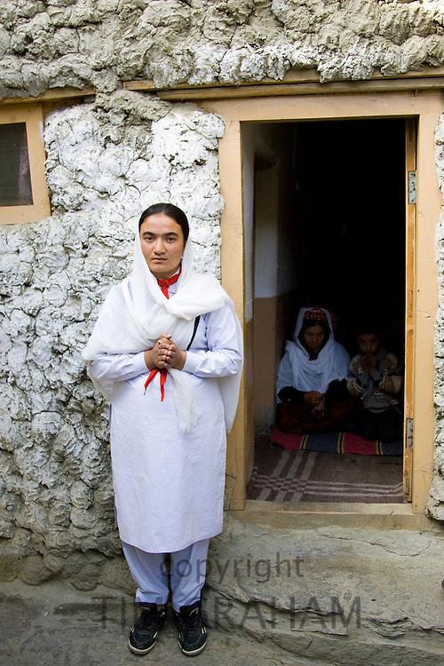 Women in her home in mountain village of Altit in Hunza region of Karokoram Mountains, Pakistan