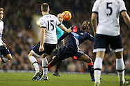 Eric Dier of Tottenham Hotspur pulls the shirt of  Georginio Wijnaldum of Newcastle United .Barclays Premier league match, Tottenham Hotspur v Newcastle Utd at White Hart Lane in London on Sunday 13th December 2015.<br /> pic by John Patrick Fletcher, Andrew Orchard sports photography.