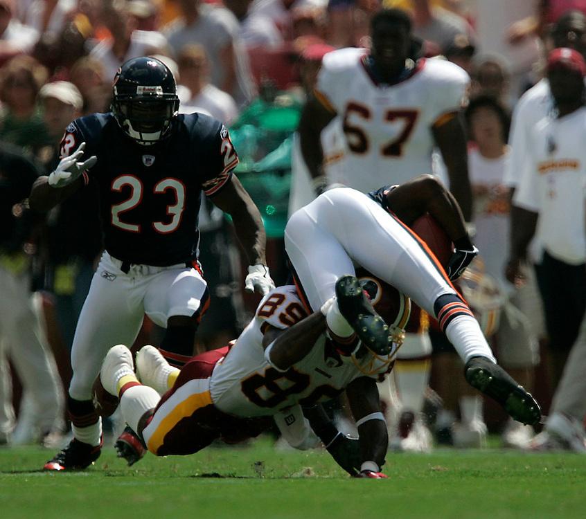 Jay Westcott/Examiner  SP   Sept. 11, 2005 - Washington Redskins vs. Chicago Bears - Santana Moss #89 tackles Bears cornerback # 31 Nathan Vasher after he intercepted a pass from Patrick Ramsey.