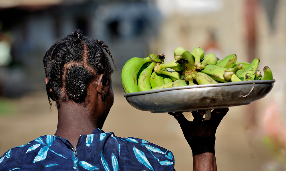 A woman carries bananas in the Haitian village of Vaudreuil.