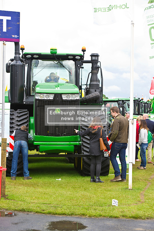 Pictured: Potential purchasers try out the Jiohn Deere tractor costing half a million pounds<br /> <br />  The crowds gathered at the Royal Highland Show today as all things farming were on display. The sunshine and showers weather did not disuade visitors  to open their wallets and purses as they toured the 4,000 stands available<br /> <br /> Ger Harley: Edinburgh Elite media