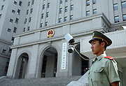 A Chinese soldier guards the entrance to a Beijing court house where the sentencing of Hong Kong reporter Ching Cheong took place August 31, 2006. Ching, 56, was sentenced to five years in prison on espionage charges, the latest step in a widening Chinese crackdown on the media and on dissent. He had faced the death penalty but the Beijing Number Two Intermediate Peopleís Court said that it had shown leniency because Mr Ching had confessed.