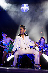 "© Licensed to London News Pictures . 26/06/2013 . Manchester , UK . Saturday Night Fever spoof during the show . The Ladyboys of Bangkok perform their show , "" Glamorous Amorous "" at the Sabai Pavilion , in Manchester , as part of their 2013 UK tour . Photo credit : Joel Goodman/LNP"