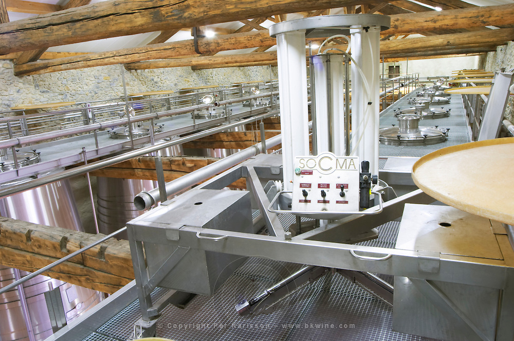 Chateau Grand Moulin. In Lezignan-Corbieres. Les Corbieres. Languedoc. Stainless steel fermentation and storage tanks. Equipment for pigeage, pushing down the cap of grape skins and pips. France. Europe.