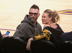October 20, 2018 - Los Angeles, California, U.S - Adam Levine and Behati Prinsloo attend the NBA game between the Los Angeles Lakers and the Houston Rockets on Saturday October 20, 2018 at the Staples Center in Los Angeles, California. (Credit Image: © Prensa Internacional via ZUMA Wire)