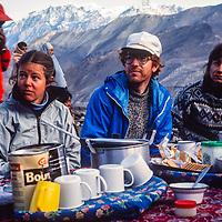 Trekkers enjoy a seated trailside breakfast during a trek around Annapurna in Nepal.