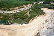 Nederland, Limburg, Gemeente Maastricht, 27-05-2013<br /> Grotten in de Sint-Pietersberg, bij de ENCI-mergelgroeve voor de winning van mergel (eigenlijk kalksteen) in dagbouw door cementfabriek ENCI. Maastricht aan de horizon. Wat er nog resteert van de St.Pietersberg, rond de greeve, is beschermd natuurgebied en bovengronds en ondergronds aangewezen als beschermd Habitatrichtlijngebied.<br /> Caves near the marl quarry for the extraction of marl (limestone actually) in surface mining by cement factory ENCI. Maastricht at the horizon. What is left of the Sint-Pietersberg is designated as protected area, both on groundlvel and underground the habitat directives apply.<br /> luchtfoto (toeslag op standaardtarieven);<br /> aerial photo (additional fee required);<br /> copyright foto/photo Siebe Swart.