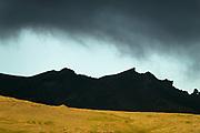 The glacier under a dark cloud.