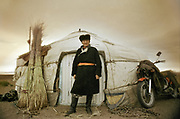 A man of the Kazkah minority stands proud in front of his yurt in Western Mongolia, Baya Olgii province.