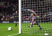 Photo. Glyn Thomas<br />Charlton Athletic v Luton Town. Carling Cup 2nd round.<br />The Valley, Charlton. 23/09/2003.<br />Charlton keeper Dan Kiely makes the final save off Chris Coyne in the penalty shootout to send his team into the next round.