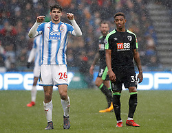AFC Bournemouth's Jordon Ibe and Huddersfield Town's Christopher Schindler enduring the bad weather during the Premier League match at the John Smith's Stadium, Huddersfield.