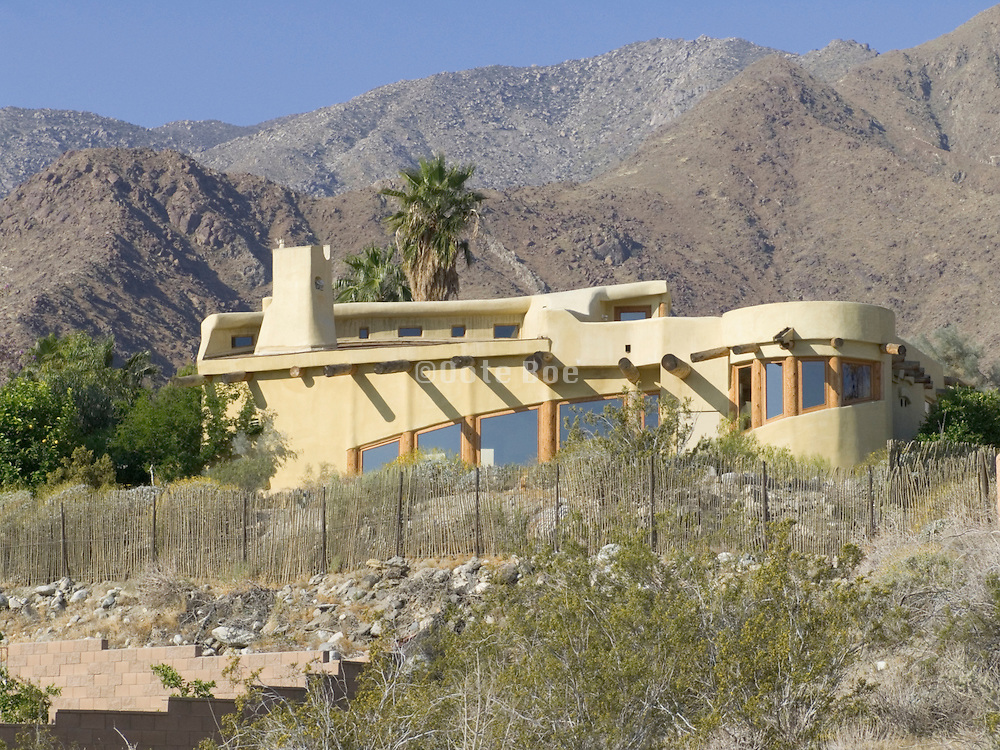 New adobe house against mountain scenery Palm Springs USA.