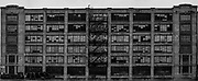 United 54; September 30th, 2020; Photography; 7.833 in. x 19 in. x .1 in.<br /> <br /> Urban decay is natural, especially in a city as old as Memphis. Locations subject to urban decay<br /> are generally considered abandoned and are often thought of as an eyesore, if not totally<br /> forgotten. While urban decay may be seen as a failure of the system to keep up with the<br /> changing times, I see it as a unique opportunity to record buildings and other locations<br /> crumbling under the weight of time and decorated with street art before they are gentrified or<br /> destroyed through other means.<br /> United 54 is an image of the long abandoned United Warehouse located on E. H. Crump<br /> Boulevard and Kentucky Street. This image was created by stitching together 54 individual<br /> photos of the exterior of the building. The original image is 10 feet by about 4 feet in order to<br /> fully show detail on the building, but due to print limitations the image presented has been<br /> shrunk down.<br /> Waiting is an image of a friend, a civil engineering major with similar interests in urban decay,<br /> leaning against a neglected barrier covered in graffiti across the train tracks from the United<br /> Warehouse. Waiting is a part of a series of images I took during the Spring 2020 semester when<br /> I began experimenting with images of urban decay and candid photography. The series of<br /> images with my friend explore urban decay around the Memphis area as well as graffiti, and<br /> new and old structures.