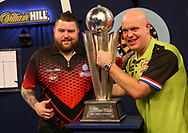 Michael van Gerwen celebrates with the trophy with Michael Smith during the 2019 William Hill World Darts Championship Final at Alexandra Palace, London, United Kingdom on 1 January 2019.