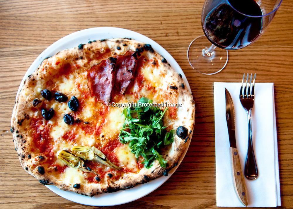 060710-Falls Church, Va: A Quatro Stagioni Pizza at Pizzeria Orso in Falls Church, Virginia. Photo by Kris Connor