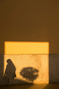 Shadow of woman on wall at sunset, Cadiz, Andalusia, Spain