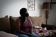 Florence Hobbs sits on the couch at her friend's home in Charleston, South Carolina on Wednesday, August 19, 2020. Ms Hobbs was evicted from her apartment after two job losses and a positive COVID-19 test. <br /> <br /> Credit: Cameron Pollack for The Guardian.