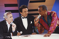 File photo taken in the 80's of French TV Presenter Michel Drucker flanked by Charles Aznavour and Harry Belafonte on the set of Champs Elysees. Photo by Pascal Baril/ABACAPRESS.COM