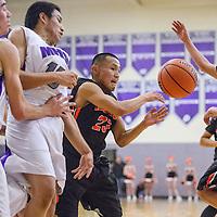 Gallup Bengal Shawn Skeets (23) passes the ball away from Miyamura Patriot Matthew Dooley (22) Tuesday at Miyamura High School.