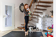 Prima ballerina Iana Salenko practices as she holds to her son William at their home in Berlin, Germany, 16 April 2020. As the shows of Berlin's State Ballet (Staatsballett Berlin) are on a halt, due to the health restrictions, the group's Principal Dancer Iana Salenko and her husband Berlin State Ballet First Solo Dancer Marian Walter, try to maintain a balance between staying in shape and raising their two boys. The German government plans to slowly ease the lockdown restrictions imposed during the spread of the  coronavirus SARS-CoV-2 disease, which causes the COVID-19 disease.